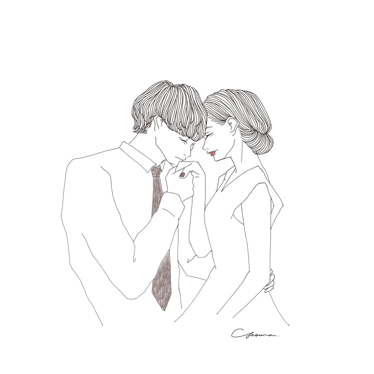 女性の手にキスする男性